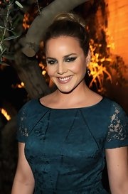Abbie Cornish attended the Restoration Hardware spring 2012 launch wearing her hair in a stylish loose bun.