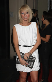 Liz Mcclarnon paired a gunmetal gray clutch with her little white dress for a totally chic look.