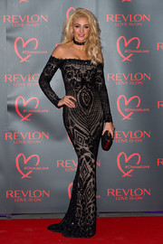 Michelle Keegan looked supremely glam in a beaded black off-the-shoulder gown at the Revlon Choose Love Masquerade Ball.