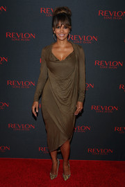 Halle Berry chose a Donna Karan  draped midi dress in a golden brown hue for the Revlon Love is On event.