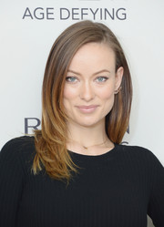 Olivia Wilde attended Revlon's New Age Defying collection launch wearing a simple yet chic layered cut.