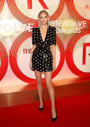 Elsa Hosk coordinated her dress with a pair of studded black pumps.