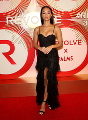 Draya Michele went for sexy glamour in a tiered black lace gown by Majorelle at the #REVOLVEawards.