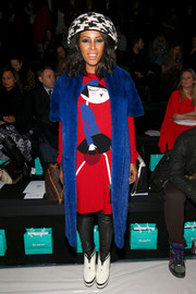 June Ambrose sported a head-turning color combo at the Richard Chai Love fashion show in a cobalt fur coat layered over a red print dress.