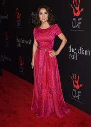 Salma Hayek kept it modest and classy at the Diamond Ball in a short-sleeve, drape-accented Alexander McQueen gown subtly patterned in red and pink.