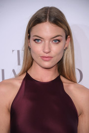 Martha Hunt attended the Diamond Ball sporting a pin-straight hairstyle with a center part.