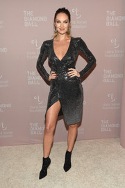 Candice Swanepoel styled her sexy dress with embellished black ankle boots.