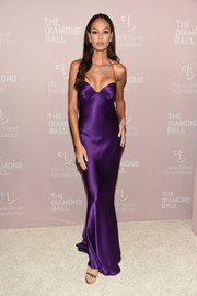 Joan Smalls smoldered in a violet satin slip gown by Roberto Cavalli Couture at the Diamond Ball.