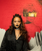 Rihanna seemed in a hurry for Halloween when she sported this dark shade of lipstick.