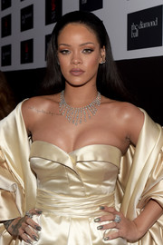 Rihanna sported metallic nail polish to match her shimmery gown at the Diamond Ball.