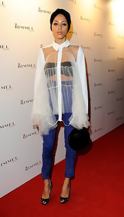 Ana Araujo was flamboyantly dressed in a sheer white ruffle blouse at the Rimmel and Kate Moss party.
