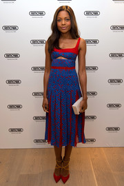 Naomie Harris brought a striking pop of color to the Rimowa flagship store opening with this blue and red cutout dress.