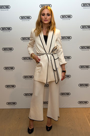 Olivia Palermo looked pristine, as always, in a loose, belted white pantsuit at the Rimowa flagship store opening in London.