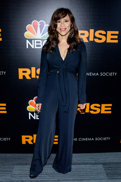 Rosie Perez worked a navy tie-waist jumpsuit with a plunging neckline at the New York premiere of 'Rise.'