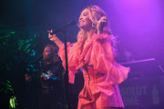 Rita Ora oozed sweetness wearing this pink ruffle blouse by Prabal Gurung at the Grammy Awards weekend kickoff.