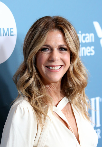 Rita Wilson Long Wavy Cut [the hollywood reporter,hair,blond,human hair color,hairstyle,beauty,chin,long hair,layered hair,smile,hair coloring,power 100 women in entertainment - red carpet,power 100 women in entertainment,rita wilson,california,los angeles,hollywood reporter,milk studios]