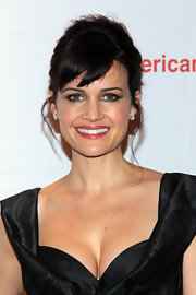 Carla Gugino wore her hair in a polished French Twist with sexy side-swept bangs and soft wavy tendrils at the opening night of 'The Road to Mecca.