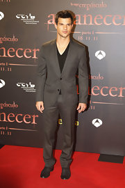 Taylor Lautner wore a charcoal pinstripe suit with a deep-v black tee at the 'Breaking Dawn' premiere in Spain.