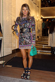 Anna dello Russo looked bold and chic in a fully beaded mini dress by Emilio Pucci during the Roberto Cavalli boutique opening.