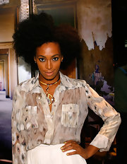 Solange flashed her golden nail lacquer while attending the Roberto Cavalli Fashion Night Out.