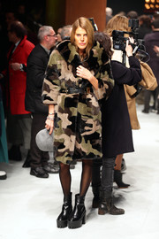 Anna dello Russo was tough-glam in a Michael Kors camo fur coat during the Roberto Cavalli fashion show.