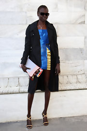 Alek Wek topped off her style with strappy sandals.