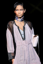 Chanel worked a floral neck scarf for the Roberto Cavalli runway show in Milan.