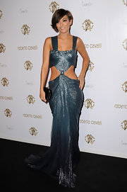 Frankie Sandford looked undeniably sexy at the Roberto Cavalli launch in a glistening gun metal dress with revealing side cutouts.