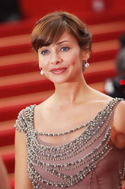 Natalie Imbruglia was fresh-faced at the Cannes Film Festival with this bobby-pinned updo and girly bangs.