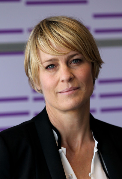Robin Wright Emo Bangs [hair,hairstyle,blond,eyebrow,forehead,chin,white-collar worker,official,layered hair,hair coloring,robin wright,photocall,press centre,doha,qatar,doha tribeca film festival]