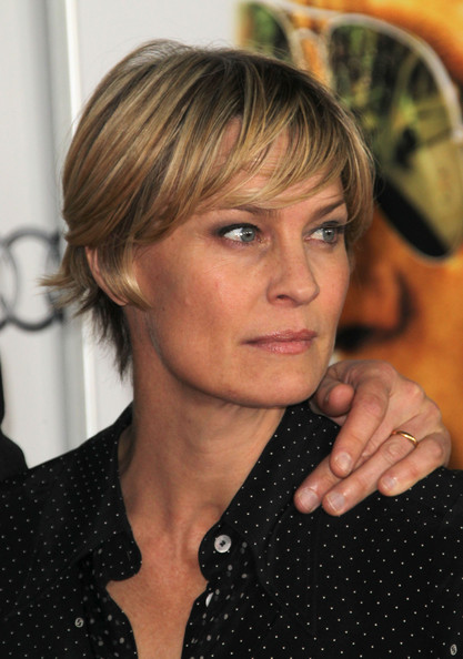 Robin Wright Layered Razor Cut [hair,face,hairstyle,blond,eyebrow,bangs,chin,forehead,brown hair,long hair,robin wright,rampart special screening - arrivals,grauman,rampart,chinese theatre,california,hollywood,audi,afi fest,screening]