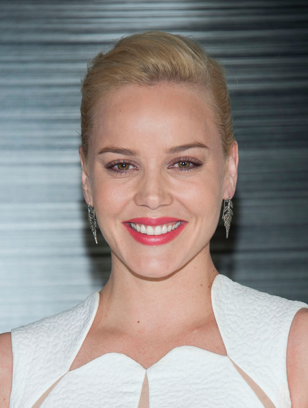 Abbie Cornish attended the 'RoboCop' photocall looking classic with her side-parted bun.