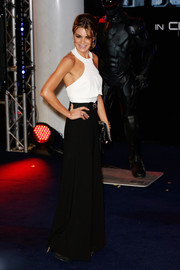 Charlotte Jackson teamed her halter top with a pair of flared black pants for a '70s-chic vibe.