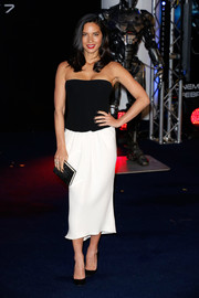 Olivia Munn opted for a sleek monochrome strapless dress by Giorgio Armani when she attended the 'Robocop' premiere in London.