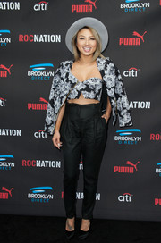 Jeannie Mai donned a floral zip-up jacket and a matching bustier for the Roc Nation pre-Grammy brunch.