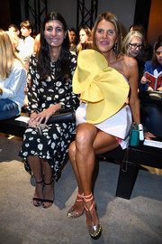 At the Rochas fashion show, Anna dello Russo stole the limelight in a strapless white Delpozo mini adorned with a humongous yellow flower.