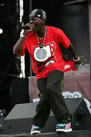 Flava Flav wearing his iconic clock necklace.