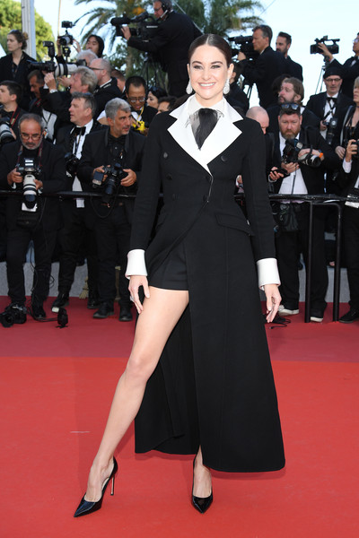 Shailene Woodley flashed her leg in a black Dior Couture cashmere coat layered over matching shorts at the 2019 Cannes Film Festival screening of 'Rocketman.'