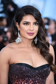 For her beauty look, Priyanka Chopra went playful with a hollow cat eye.