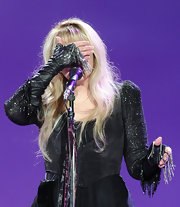 Stevie Nicks' black cropped jacket sported a strong silhouette, and the sparkly sleeves added a feminine feel.