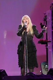 Stevie Nicks looked ultra feminine in a tiered ruffle LBD.