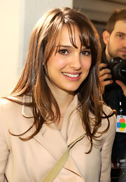 Natalie Portman wore her hair straight with wispy bangs at the Rodarte fall 2012 fashion show.