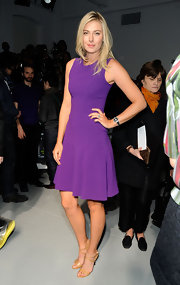 Maria topped off her purple dress with nude strappy sandals.