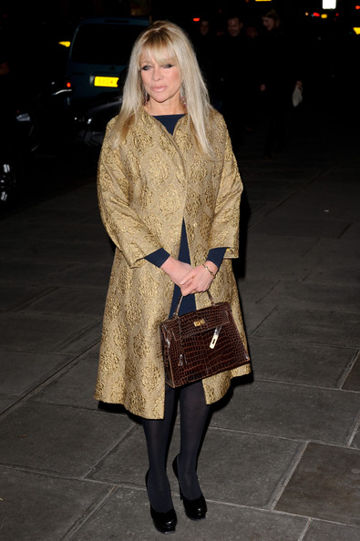 Jo looked almost regal in her opulent gold coat as she made her way to the Rodial Beautiful Awards 2012 in London.