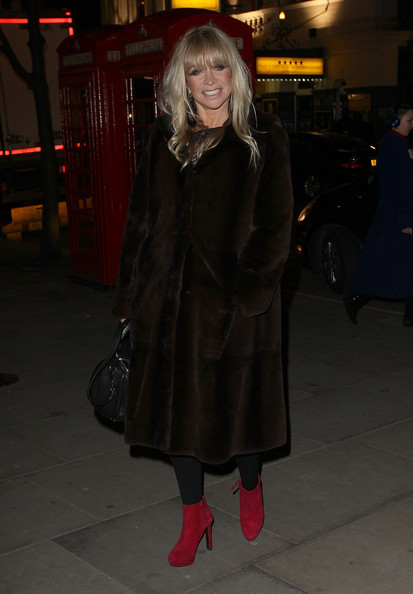 Jo Wood dressed up her evening look with this long, brown, fur coat.