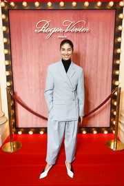 Caroline Issa opted for a baggy baby-blue pantsuit when she attended the Roger Vivier press day.