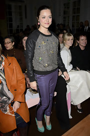 Zoe Tapper's crewneck sweater showed a bit of her funky side with leather sleeves and baubles sewn on the front.