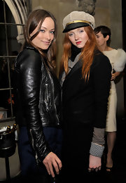 Lily Cole topped off her busy ensemble with a beige and black newsboy cap when she attended the launch of Roland Mouret's Rainbow Collection.