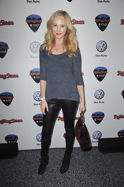 Candice opted for leather leggings and black lace-up kicks.