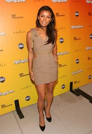 Melody wore a funky, cutout mini dress with patent leather, paltform Bianca Pumps.